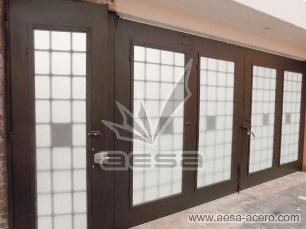 1250-511-porton-cuadricula-tubos-nudos-vidrio-chapetones-vista-interior-puerta